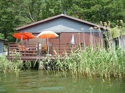 Ferienhaus Bootshaus Ferienhaus auf dem See mit Boot und Süd See...
